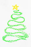 Crayon Christmas tree. Crayon curved Christmas tree drawing with yellow star Stock Photography
