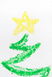 Crayon Christmas tree detail. Detail of the top of a Christmas tree with yellow star drawn in crayon Royalty Free Stock Photo