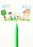 Crayon close-up with a drawing of a family Royalty Free Stock Images