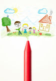Crayon close-up with a drawing of a family Royalty Free Stock Photos