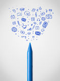 Crayon close-up with social media icons Stock Photo