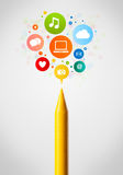 Crayon close-up with social network icons Stock Photo