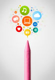 Crayon close-up with social network icons Royalty Free Stock Photography