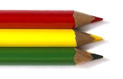 Crayon coloré par trois sur le fond blanc Photographie stock libre de droits