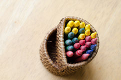 Crayon colorful in basket on wood table Royalty Free Stock Photography