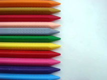 Crayon colors on white paper. Crayon colors inline on white paper Stock Image