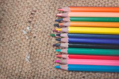 Crayon. Isolated on Sackcloth background Stock Photography