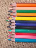 Crayon. Isolated on Sackcloth background Royalty Free Stock Photos