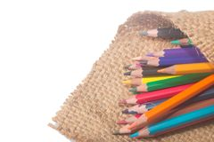 Crayon. Isolated on Sackcloth background Royalty Free Stock Photography