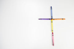 Crayon cross on white background