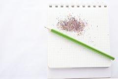 Crayon de couleur et un carnet Photographie stock