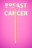 Crayon effaçant les mots CANCER DU SEIN Photographie stock libre de droits