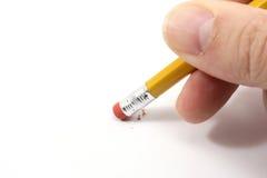 Crayon effaçant sur le papier. photos stock