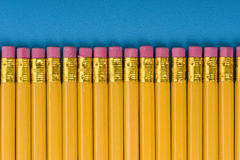 Crayon with eraser on blue Royalty Free Stock Image