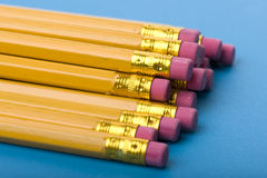 Crayon with eraser on blue close up Royalty Free Stock Image