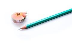 Crayon et épluchages verts Photographie stock