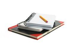Crayon et carnets Photographie stock