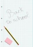 Crayon et gomme sur un carnet écrit feuille quadrillée Images stock