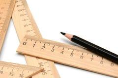 Crayon et grilles de tabulation sur un fond blanc. Photographie stock
