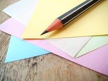 Crayon et note Photographie stock libre de droits