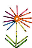 Crayon Flower. A set of crayons is used to create a flower design. This is used to instill a child creativity royalty free stock photos