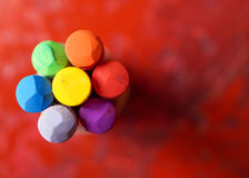 Crayon flower on red Stock Images