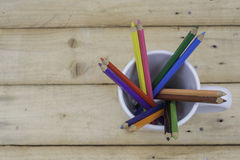 Crayon in glass. Crayon glass color full wood Royalty Free Stock Images