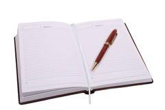 crayon lecteur brun de cahier Photos libres de droits