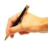 Crayon lecteur de bille dans une main Photographie stock