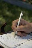 Crayon lecteur de whith de main Photo stock