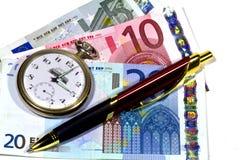 Crayon lecteur et argent d'horloge Image libre de droits