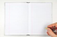 Crayon lecteur et bloc-notes Photo stock