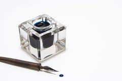 Crayon lecteur et encrier encastré Photos stock