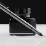 Crayon lecteur et encrier encastré Image libre de droits
