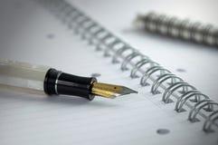 Crayon lecteur et papier Photographie stock libre de droits