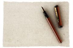 Crayon lecteur et vieux papier Photographie stock