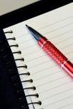 Crayon lecteur sur des notes image libre de droits