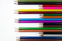 Crayon. Many pencil sticks on plain white paper Stock Image