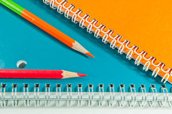 Crayon and notebook Stock Photos