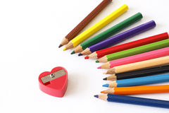 Crayon and pencil sharpener Royalty Free Stock Photo