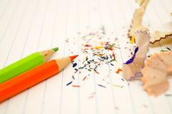 The crayon and piece of wood junk and colorful graphite. The crayon and piece of wood junk and colorful graphite on the paper Royalty Free Stock Photos