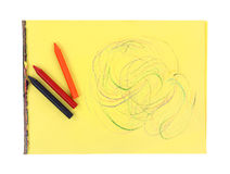 Crayon Sticks Large Side Swirls Yellow Tablet. Three large crayon sticks on yellow tablet with swirls Royalty Free Stock Photo
