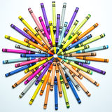 Crayon Sunburst. A colorful array of crayons configured into a round sunburst. What child did not spend hundreds of hours playing with crayons and drawing royalty free stock photography