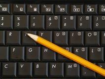 Crayon sur le clavier d'ordinateur Images libres de droits
