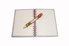 Crayon sur le livre de journal intime Photos libres de droits