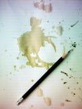 Crayon sur le vieux papier Photographie stock libre de droits