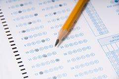 Crayonnez sur l'examen Photos stock