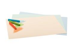 Crayons масла пастельные лежа на бумаге стоковое фото rf