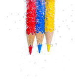 Crayons. Crayons is surrounded by a lot of bubbles stock images