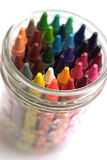 Crayons. Image of a glass filled with colorful crayons, on a white background Stock Image